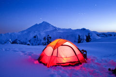 Lit-up Tent on Snow Mountain under Starry Sky Stock Photography