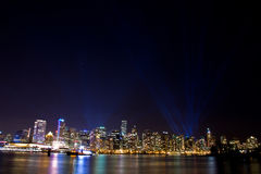 Lit up Vancouver, BC skyline with spotlights Royalty Free Stock Photography
