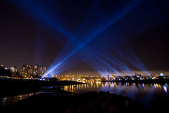 Lit up Vancouver, BC skyline with spotlights Stock Image