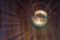 Lit vintage candle lantern Stock Photography