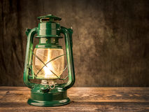 Lit vintage oil lamp Stock Photos