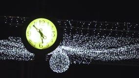 Lit vintage town clock stock footage