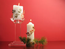 Lit white Christmas candles with festive holiday gold decoration Royalty Free Stock Photo