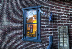 Lit window on a brick wall Royalty Free Stock Image