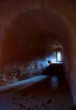 Lit window in dark fortress. Lit window in dark arch niche of dungeon stock photo