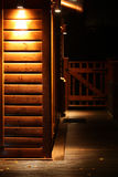 Lit wooden wall on a cabin. Spotlight on a wooden wall on a cabin royalty free stock image