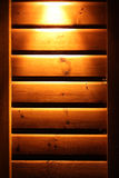 Lit wooden wall on a cabin. Spotlight on a wooden wall on a cabin stock photos