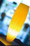 Lit yellow lamp. With blurry background Royalty Free Stock Photos