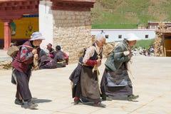 LITANG, CHINA - Jul 17 2014: Pilgrim at Ganden Thubchen Choekhor Royalty Free Stock Photo