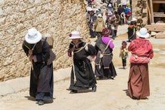 LITANG, CHINA - Jul 17 2014: Pilgrim at Ganden Thubchen Choekhor Stock Photo