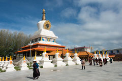 LITANG, CHINA - Jul 17 2014: Pilgrim at White pagoda park. a fam Royalty Free Stock Images