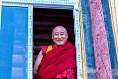 LITANG and GANZI, CHINA - MAY 02, 2016 : Unidentified buddhist monks smiling are praying in Boudhanath monastery Royalty Free Stock Photos