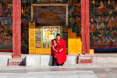 LITANG and GANZI, CHINA - MAY 02, 2016 : Unidentified buddhist monks smiling are praying in Boudhanath monastery Stock Image