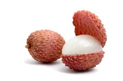 Litchi. Two litchies one of them is cut in half stock image