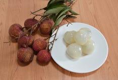 Litchi Asian fruit on dish Stock Photos