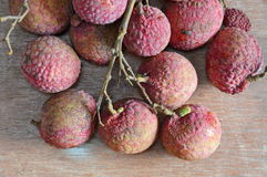 Litchi Asian fruit on wooden board Royalty Free Stock Photo