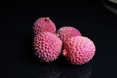 Litchi chinensis lychee sweet fruit on black background royalty free stock photo