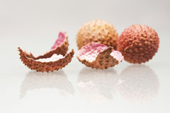 Litchi fruits and peels Stock Photo