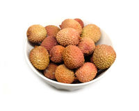 Litchi fruits in round bowl isolated on white closeup Royalty Free Stock Images