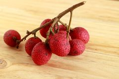 Litchi on wooden table. royalty free stock photos