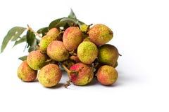 Litchiplommonfruktbukett på vit bakgrund Fotografering för Bildbyråer