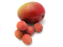 Litchis with mango fruit. Five litchis with one big mango fruit. Image isolated on white studio background Royalty Free Stock Photography