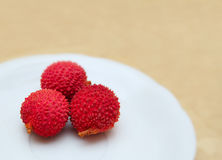 Litchis on the plate Stock Photos