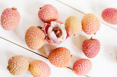 Litchis on a table Stock Images
