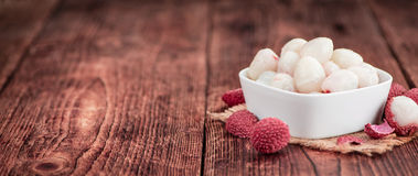 Litchis on vintage wooden background Stock Photos