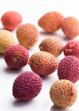 Litchis on white background, closeup Stock Photos