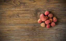 Litchis on wooden Royalty Free Stock Images