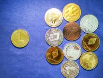 Lite coin and others crypto coin on blue cloth. Virtual cryptocu Stock Photos