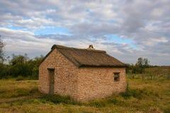 Lite hus i sätta in Royaltyfri Fotografi