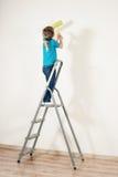 Lite hus-målare fotografering för bildbyråer