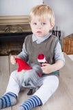Lite litet barnpojke med jultoys Fotografering för Bildbyråer