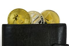 Litecoin, bitcoin and ethereum lie in black leather wallet closeup. Silver litecoin, golden bitcoin and silver ethereum  lie in black leather wallet closeup  on Royalty Free Stock Photography