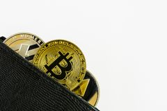 Litecoin, bitcoin and ethereum lie in black leather wallet closeup. Silver litecoin, golden bitcoin and silver ethereum  lie in black leather wallet closeup  on Stock Images