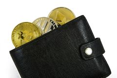 Litecoin, bitcoin and ethereum lie in black leather wallet closeup. Silver litecoin, golden bitcoin and silver ethereum  lie in black leather wallet closeup  on Stock Photography