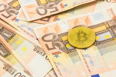 Litecoin and bitcoin with money 50 euro bills. business concept Royalty Free Stock Photo