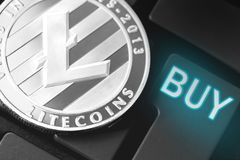 Litecoin with buy button closeup. Litecoin cryptocurrency coin with buy button closeup stock photo