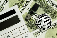 Litecoin, calculator and dollars calculations of the new cryptocurrency. Litecoin, dollars calculations of the new cryptocurrency Stock Photo