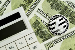 Litecoin, calculator and dollars calculations of the new cryptocurrency. Litecoin, dollars calculations of the new cryptocurrency Royalty Free Stock Image