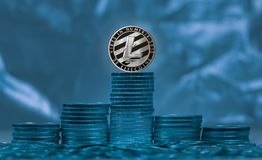 Litecoin coin against background of light and shade Stock Image