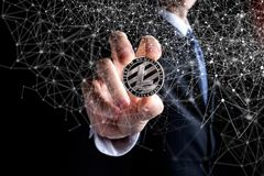 Litecoin coin held out by a man in a suit Royalty Free Stock Photo