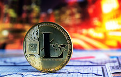 Litecoin on colorful background. Golden litecoin on colorful background Royalty Free Stock Photos