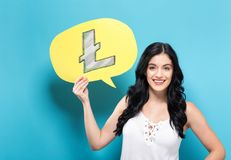 Litecoin com a mulher que guarda uma bolha do discurso imagens de stock royalty free