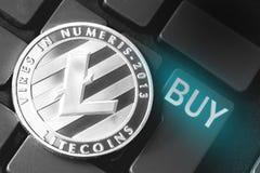 Litecoin con el bot?n de la compra imagen de archivo