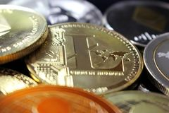 Litecoin crypto currency amoung other coins. On a pile stock image
