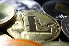 Litecoin crypto currency amoung other coins. On a pile stock photography