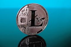 Litecoin crypto currency coin on reflective colorful background Royalty Free Stock Photos